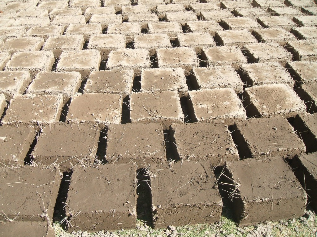 Adobe brick making izreal for How to build adobe homes